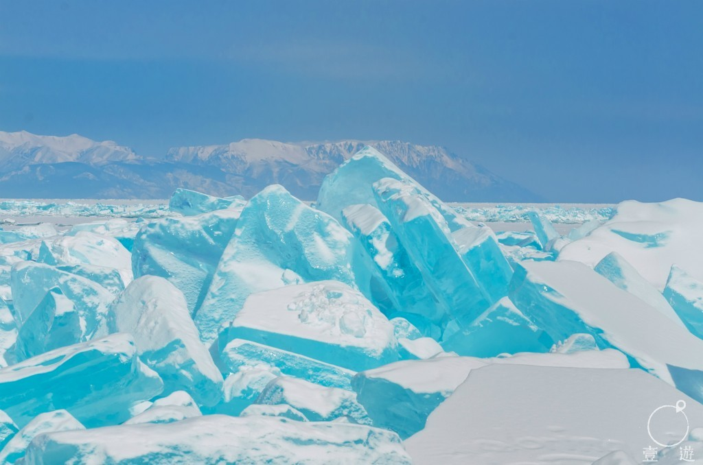 (edited) Turquoise ice hummock on the ice of lake Baikal Russia
